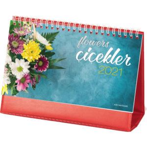 Çiçek Desen Masa Takvimi Yaprak Ebat : 20 x 11 cm Yaprak Kağıt : 170 gr. Parlak Kuşe Taşıyıcı Ebat : 20 x 14 cm Taşıyıcı Türü :400gr. BİALA Reklam Alanı: 19 x 2,5 cm